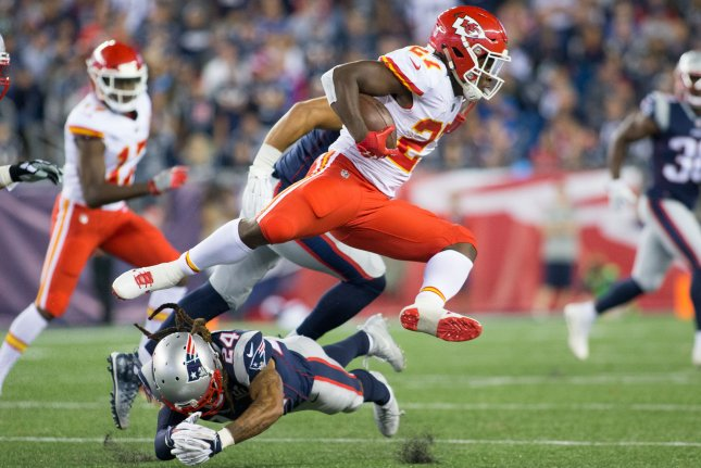 Kansas City Chiefs running back Kareem Hunt (27) dodges a tackle by New England Patriots cornerback Stephon Gilmore (24) on a carry in the fourth quarter at Gillette Stadium in Foxborough, Massachusetts on September 7, 2017. File photo by Matthew Healey/UPI