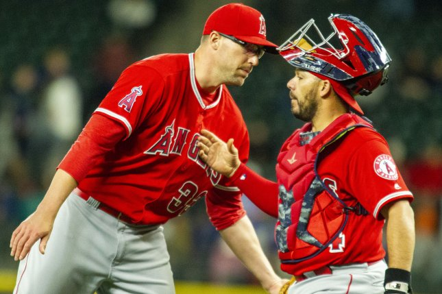 Los Angeles Angels' closer Jim Johnson (33) his congratulated by his catcher Rene Rivera after preserving a 5-0 win over the Seattle Mariners on May 4 at Safeco Field in Seattle. Photo by Jim Bryant/UPI