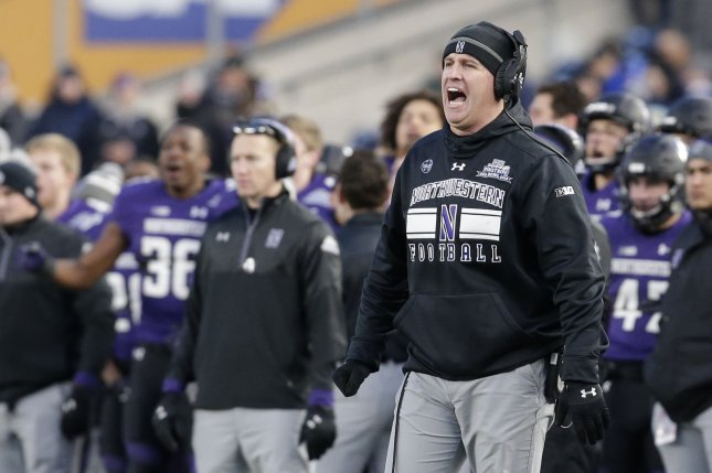 Northwestern Wildcats head coach Pat Fitzgerald calls out to his team from the sideline in the second half against the Pittsburgh Panthers on December 28, 2016 at the Pinstripe Bowl at Yankee Stadium in New York City. File photo by John Angelillo/UPI