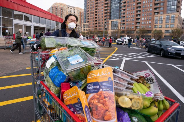 A shopper leaves a Costco Warehouse in Alexandria, Va., a suburb of Washington, D.C., on Saturday. Photo by Kevin Dietsch/UPI