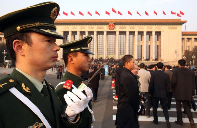 Chinese police stand guard as delegates arrive for the opening session of the annual National People's Congress (NPC) being held in the Great Hall of the People in Beijing March 5, 2011. China's spending on police and domestic survelliance will hit new heights, with public security outlays outstripping the defense budget for the first time as Beijing cracks down on protest calls. UPI/Stephen Shaver