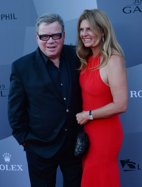 William Shatner and his wife Elizabeth Shatner at the Los Angeles Philharmonic's opening night concert at Walt Disney Concert Hall on Sept. 29. The actor is setting his sights on a 'Star Trek' musical to celebrate the show's 50th anniversary. File Photo by Jim Ruymen/UPI