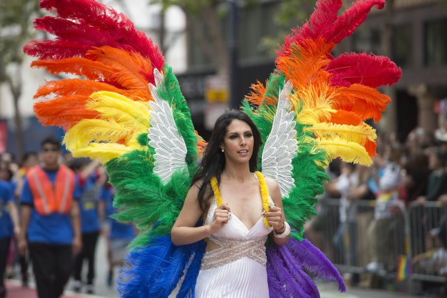 Study finds young, low-income transgender women at risk for mental illness and substance abuse. Pictured, a rainbow-feathered angel marches in the LGBT Pride parade in San Francisco on June 28, 2015. File photo by Terry Schmitt/UPI
