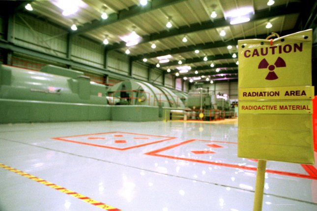 A radiation contamination warning sign stands in the middle of a secure area, next to the main generator, in the Vermont Yankee Nuclear Power Plant in Vernon, Vt. Thursday, it was reported that the United States and Britain will stage a mock cyberattack on a nuclear plant this year to test security and readiness. The nations are also expected to announce an exchange of nuclear waste. File photo by MC/SF/Steven E. Frischling/UPI