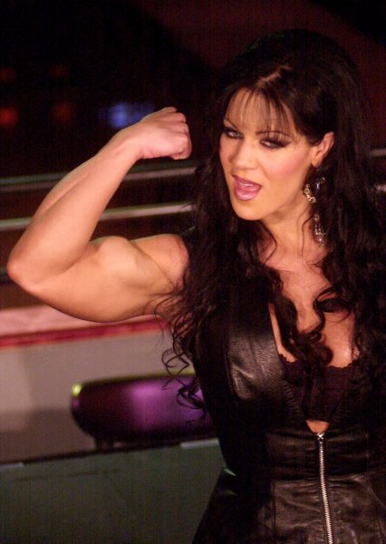 WWE Superstar Chyna flexes for the media at a 2000 promotional event for her first appearance in Playboy magazine. File Photo by Ezio Petersen/UPI