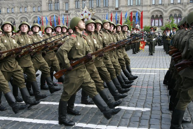 The Russian government is seeking proposals to design a new machine gun for the country's troops, shown here marching through Moscow's Red Square in 2008. File photo by Anatoli Zhdanov/UPI
