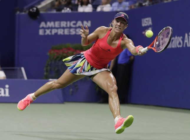 Angelique Kerber runs to return a ball. Kerber, the No. 1 seed, was upset in Aegon International quarterfinals. Photo by John Angelillo/UPI