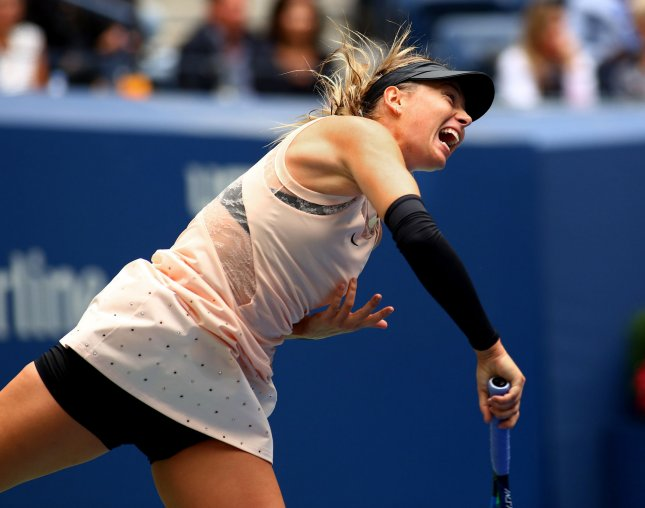 Maria Sharapova smashes a serve at the U.S. Open last month. Sharapova advanced to the semifinals of the Tianjin Open on Friday. Photo by Monika Graff/UPI