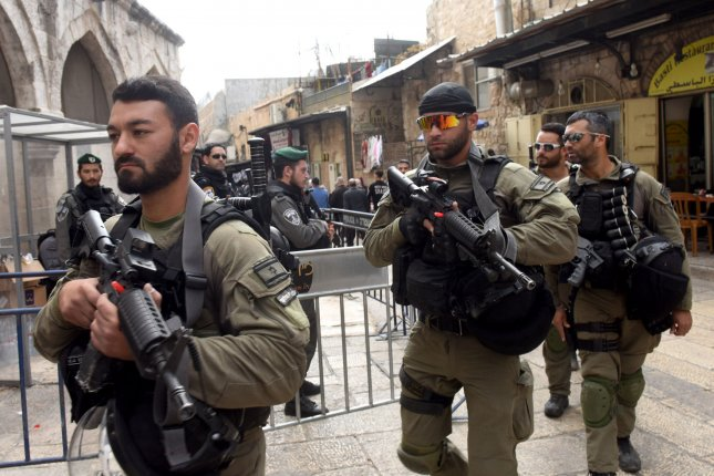 Israeli security forces patrol before Muslim Friday prayers in the Old City of Jerusalem, on Dec.15. Israel's Knesset on Tuesday made it harder to relinquish any part of Jerusalem to the Palestinians. Photo by Debbie Hill/UPI
