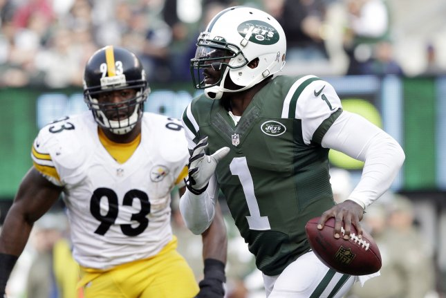 Former New York Jets quarterback Michael Vick scrambles out of the pocket in the first half in Week 10 of the NFL season on November 9, 2014 at MetLife Stadium in East Rutherford, New Jersey. File photo by John Angelillo/UPI