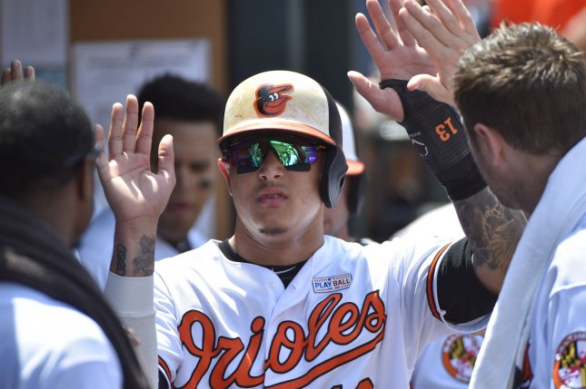 Baltimore Orioles infielder Manny Machado (C) is greeted after scoring against the Boston Red Sox during the first inning on June 4, 2017 at Camden Yards in Baltimore. Photo by David Tulis/UPI