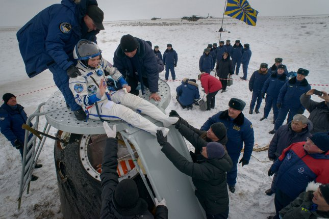 Serena Aunon-Chancellor of NASA is helped out of the Soyuz MS-09 spacecraft just minutes after she, Alexander Gerst of ESA (European Space Agency), and Sergey Prokopyev of Roscosmos, landed in a remote area near the town of Zhezkazgan, Kazakhstan, on Thursday. NASA Photo by Bill Ingalls/UPI