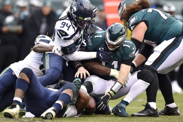 Philadelphia Eagles quarterback Carson Wentz (11) loses the ball as he is sacked against the Seattle Seahawks on Sunday at Lincoln Financial Field in Philadelphia. Wentz was without offensive linemen Brandon Brooks and Lane Johnson (concussion) in the game. File Photo by Derik Hamilton/UPI