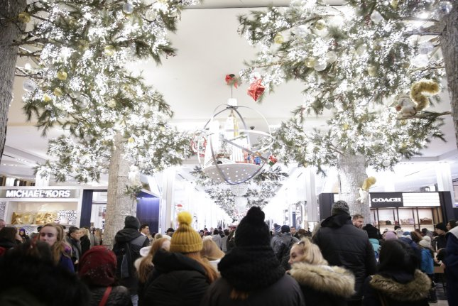 Holiday shoppers walk through Macy's department store in New York City's Herald Square. File Photo by John Angelillo/UPI