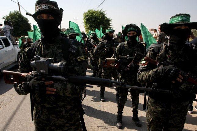 Armed Hamas militants take part in a rally in the southern Gaza Strip on November 11, 2019. Thursday's cyber report said the hackers who targeted the Palestinian Authority were affiliated with Hamas -- or were posing as affiliates of the group. File Photo by Ismael Mohamad/UPI