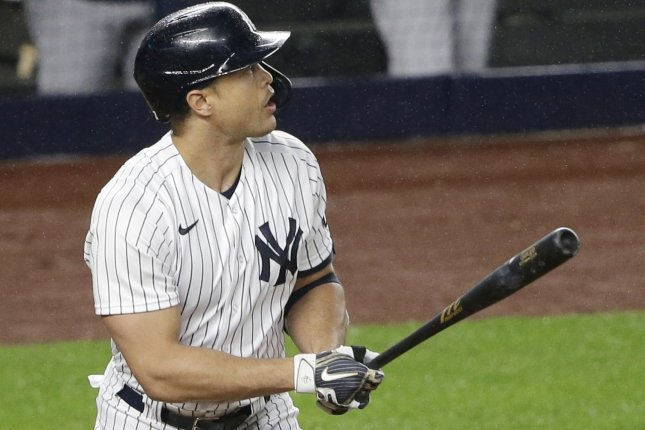 New York Yankees slugger Giancarlo Stanton hits a two-run home run in the third inning against the Houston Astros on Wednesday at Yankee Stadium in the Bronx. Photo by John Angelillo/UPI