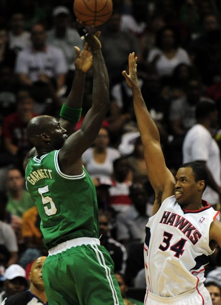 Jason Collins (34), shown in a playoff game in April 2012 playing against the Boston Celtics' Kevin Garnett (5), has written an article for Sports Illustrated in which he admits to being gay. UPI/David Tulis