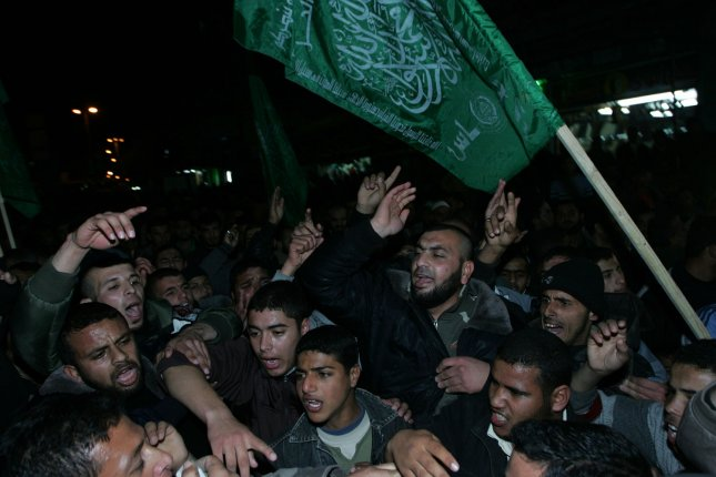 A Palestinian Hamas supporter attends a Hamas rally in Rafah in the southern Gaza Strip January 26, 2011, to protest against major concessions allegedly made by rival Palestinian leaders during peace talks with Israel, according to leaked documents, obtained by the Al Jazeera television channel. UPI/Ismael Mohamad