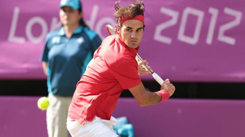 Switzerland's Roger Federer in action against America's John Isner August 2 in London. UPI/Hugo Philpott