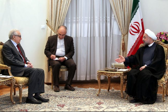 Iranian President Hassan Rouhani (R) speaks with UN-Arab League Special Envoy to Syria Lakhdar Brahimi in the Presidential Palace in Tehran, Iran on October 27, 2013. UPI/President.ir/HO