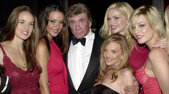 Creator and former publisher of Penthouse Magazine Bob Guccione poses with several of his Penthouse pets at the June 3, 2003 opening of his Penthouse Executive Club in New York City. (File/Ezio Petersen/UPI)