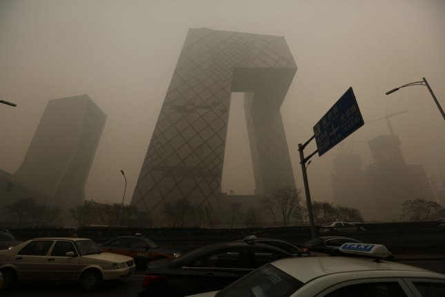 Hazardous levels of air pollution hangs over downtown Beijing on November 30, 2015. New research suggests air pollution kills 1.6 million people in China every year. Photo by Stephen Shaver/UPI