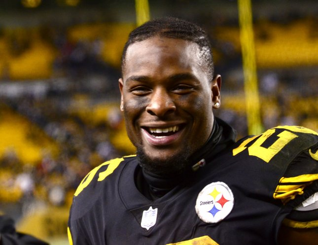 Pittsburgh Steelers running back Le'Veon Bell (26) runs off the field all smiles following the 31-27 win against the Baltimore Ravens that clinched the AFC North for the Steelers. The Steelers are now faced with trying to re-sign him. Photo by Archie Carpenter/UPI