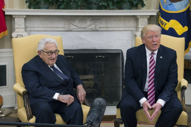 President Donald Trump meets former Secretary of State Henry Kissinger on Wednesday in the Oval Office at the White House. Photo by Molly Riley/UPI