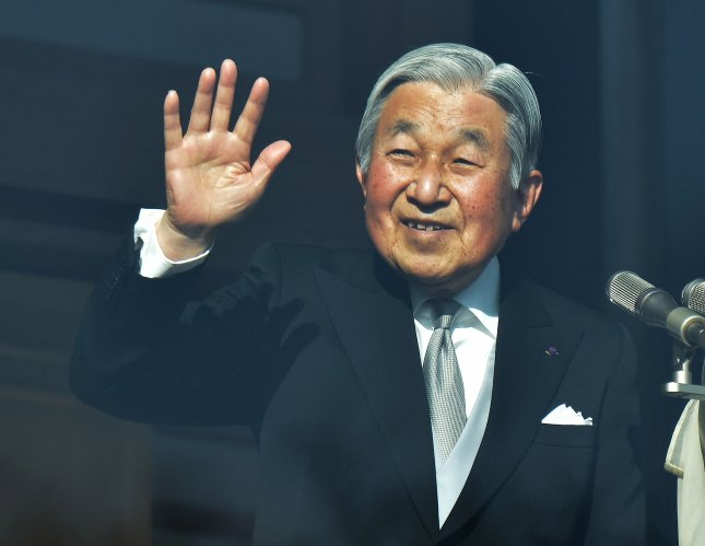 Japan's Emperor Akihito waves in Tokyo on January 2. Friday, the Japanese cabinet approved legislation permitting his abdication; it followed his announcement that failing health is limiting his public appearances. File Photo by Keizo Mori/UPI