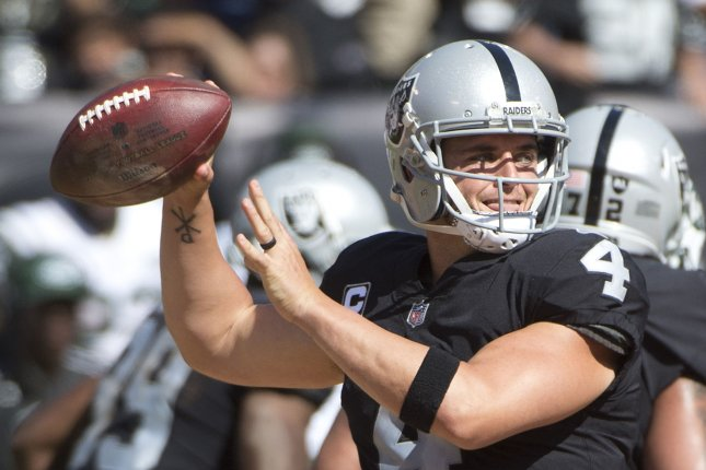 Oakland Raiders QB Derek Carr throws a pass against the New York Jets in the third quarter at the Coliseum in Oakland, California on September 17, 2017. File photo by Terry Schmitt/UPI