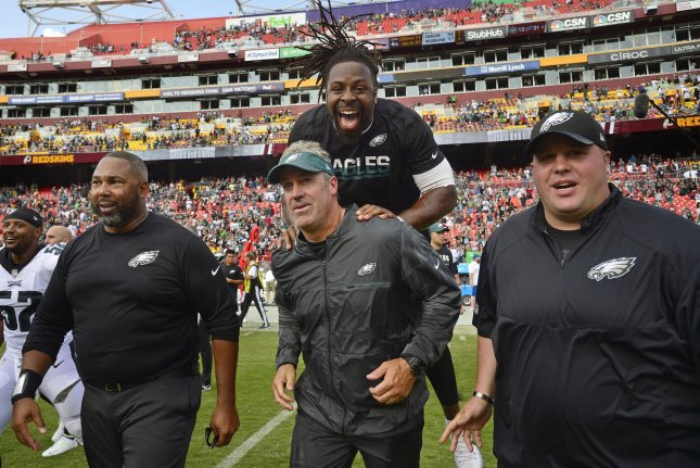 Philadelphia Eagles coach Doug Pederson (C) celebrates with teammates after defeating the Washington Redskins 30-17 during an NFL game at FedEx Field in Landover, Maryland, September 10, 2017. Photo by David Tulis/UPI