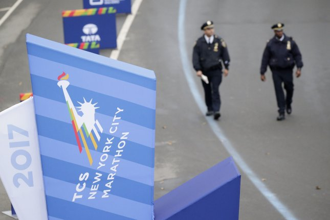 NYPD officers walk the grounds around the finish line at the NYRR TCS New York City Marathon in New York City on Sunday. Photo by John Angelillo/UPI