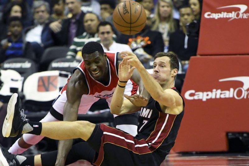 Miami Heat guard Goran Dragic (7) makes a pass from the floor against Washington Wizards. File photo by Mark Goldman/UPI