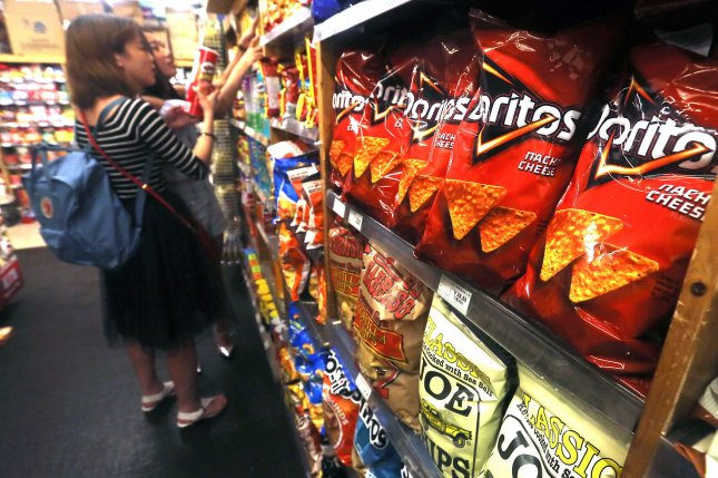 Researchers think mixing healthy food options in the same display area as junk food could nudge people to make better eating choices. Photo by Stephen Shaver/UPI