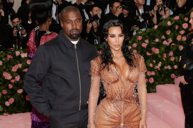 Kanye West (L) with his wife Kim Kardashian. West released on Friday his new album titled Jesus Is King. File Photo by John Angelillo/UPI