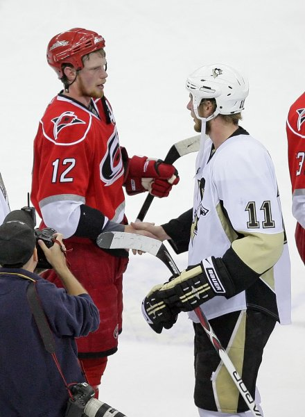 Carolina Hurricanes Eric Staal (12) congratulates his younger brother Jordan Staal (11) of the Pittsburgh Penguins after Game 4 of an NHL Eastern Conference finals Hockey game in Raleigh, North Carolina, May 26, 2009. The Penguins beat the Hurricanes 4-1 to advance to the Stanley Cup Finals. (UPI Photo/Jeff Basladynski)