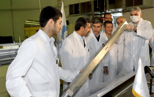 A handout picture released by the Iranian President Mahmoud Ahmadinejad's official website shows Ahmadinejad (2nd,L) and Atomic Energy Organization Chief Fereidoun Abbasi (3rd,L) visiting Tehran's nuclear reactor during the unveiling ceremony on February 15, 2012 in Tehran, Iran. Iran simultaneously unveiled three new nuclear projects on Wednesday. UPI