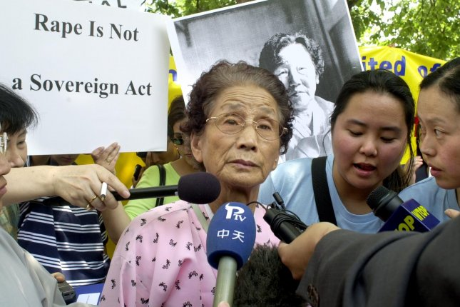 Kim Soon-Duk, a Korean survivor of World War II sexual slavery in Japan and China, speaks at a rally sponsored by The National Organization for Women outside the U.S. State Department in Washington, July 23, 2001. The rally was held to seek justice for former comfort women. (File/UPI/Jennifer Bowman)