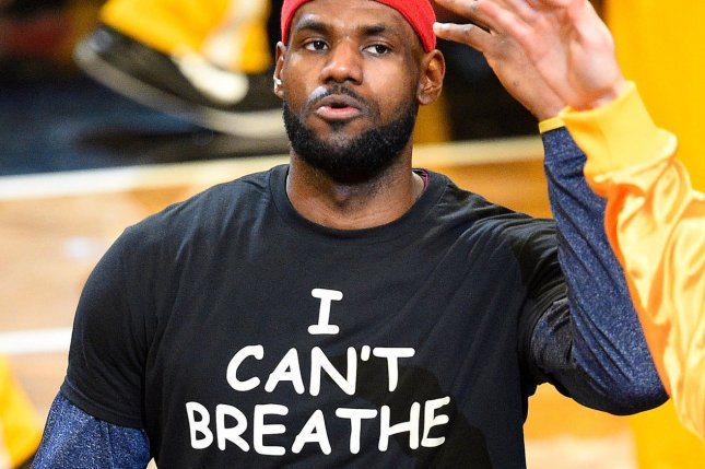 Cleveland Cavaliers forward LeBron James wears a I can't Breathe t-shirt to honor Eric Garner as he is introduced before the start of the game against the Brooklyn Nets at Barclays Center in New York City on December 8, 2014. Garner died in a conflict with police who allegedly choked him, causing his death. A New York grand jury did not indict the police officer. UPI/Rich Kane
