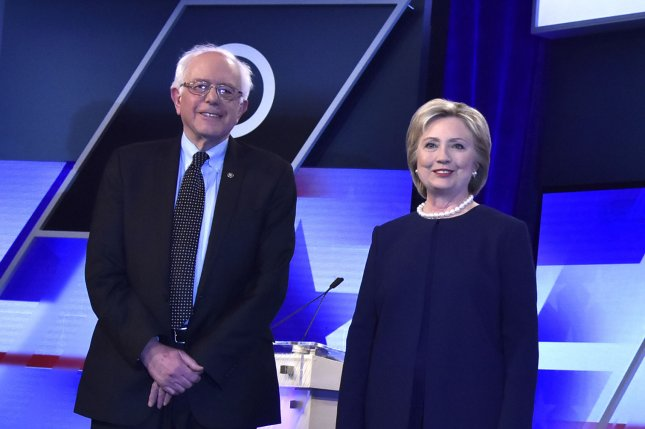 Democratic presidential candidates Sen. Bernie Sanders and Hillary Clinton, pictured Wednesday at a debate in Miami, appeared together again Sunday in a town hall event hosted by CNN. The two candidates slammed Republican presidential candidate Donald Trump, saying he has incited violence at a number of campaign events in recent days. Photo by Gary I Rothstein/UPI