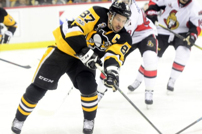 Pittsburgh Penguins center Sidney Crosby (87) loses the race to the puck during the overtime period against the Ottawa Senators during the Eastern Conference Finals of the Stanley Cup Playoffs at PPG Paints Arena in Pittsburgh. File photo by Archie Carpenter/UPI