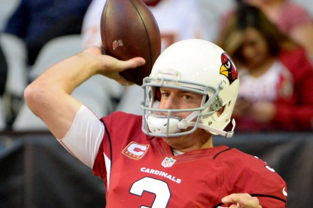 Arizona Cardinals' quarterback Carson Palmer throws a pass as he warms up before the Cardinals-Washington Redskins game at University of Phoenix Stadium in Glendale, Arizona, December 4, 2016. He is already throwing in OTAS. File photo by Art Foxall/UPI