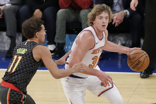 Atlanta Hawks rookie guard Trae Young (11) defends New York Knicks guard Ron Baker in the first half on Wednesday night at Madison Square Garden in New York City. Photo by John Angelillo/UPI