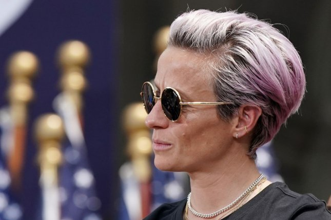 Megan Rapinoe of the United States Women's National Soccer Team listens to speakers at City Hall after a ticker tape parade on Wednesday at the Canyon of Heroes in New York City. Police said they're investigating defaced posters of Rapinoe. Photo by John Angelillo/UPI