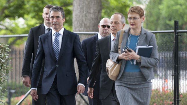 NATO Secretary-General Anders Fogh Rasmussen leaves with his entourage following an Oval Office meeting with U.S. President Barack Obama at the White House in Washington, D.C. on May 9, 2012. The two met to discuss the NATO summit which is being held in Chicago on May 20-21. UPI/Kevin Dietsch