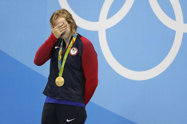 Katie Ledecky (USA) is emotional on the medal stand after receiving the gold for her record time of 8:04.79 in the Women's 800M Freestyle final in the Olympic Aquatics Stadium at the 2016 Rio Summer Olympics in Rio de Janeiro, Brazil, on August 12, 2016. Photo by Matthew Healey/UPI