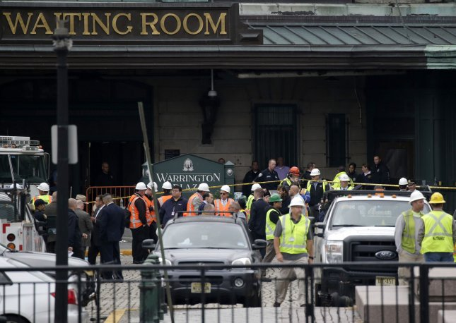 Emergency Workers and Police gather outside the Lackawanna Hoboken Terminal Train Station on September 29, 2016 In Hoboken, New Jersey. A New Jersey Transit train plowed through a major station in Hoboken during Thursday morning's rush-hour commute, killing at least one person and injuring more than 100 others. The Hoboken terminal is one of the busiest transit hubs in the New York area. Photo by John Angelillo/UPI