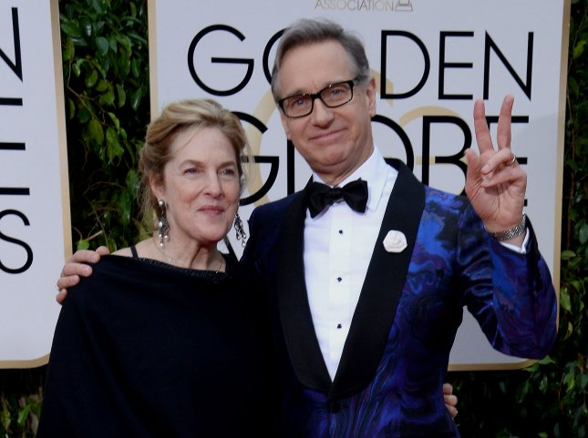 Paul Feig (R) and Laurie Karon attend the 73rd annual Golden Globe Awards on January 10, 2016. File Photo by Jim Ruymen/UP