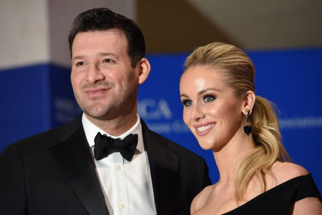Tony Romo (L) and his wife Candace Crawford- Romo arrive on the red carpet prior to the White House Correspondents Association Dinner at the Washington Hilton in Washington, DC, April 30, 2016. File Photo by Molly Riley/UPI