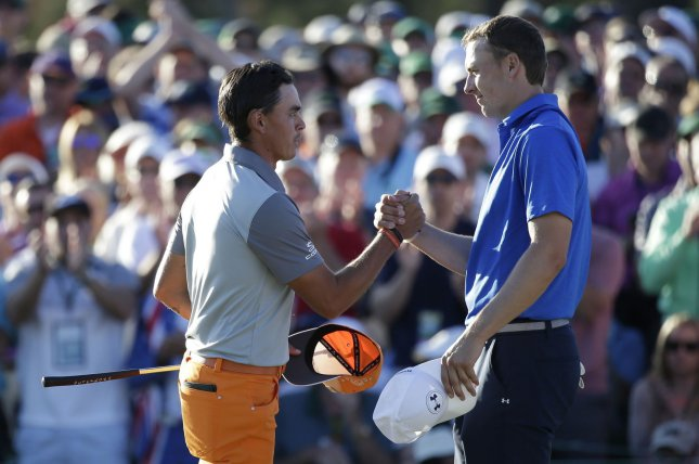 Jordan Spieth and Rickie Fowler shake hands on the 18th green in the final round of the 2017 Masters Tournament on April 9 at Augusta National Golf Club in Augusta, Ga. Photo by John Angelillo/UPI